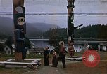 Image of totem poles Alaska USA, 1960, second 1 stock footage video 65675038983