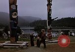 Image of totem poles Alaska USA, 1960, second 2 stock footage video 65675038983