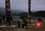 Image of totem poles Alaska USA, 1960, second 4 stock footage video 65675038983