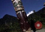 Image of totem poles Alaska USA, 1960, second 7 stock footage video 65675038983