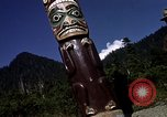 Image of totem poles Alaska USA, 1960, second 8 stock footage video 65675038983