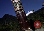 Image of totem poles Alaska USA, 1960, second 9 stock footage video 65675038983