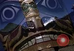 Image of totem poles Alaska USA, 1960, second 10 stock footage video 65675038983