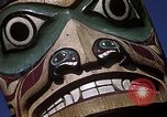 Image of totem poles Alaska USA, 1960, second 11 stock footage video 65675038983