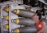 Image of airman near bomb bay of B-52 D bomber Thailand, 1969, second 3 stock footage video 65675039076