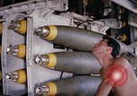 Image of airman near bomb bay of B-52 D bomber Thailand, 1969, second 4 stock footage video 65675039076