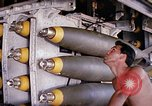 Image of airman near bomb bay of B-52 D bomber Thailand, 1969, second 7 stock footage video 65675039076
