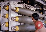 Image of airman near bomb bay of B-52 D bomber Thailand, 1969, second 9 stock footage video 65675039076