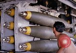 Image of airman near bomb bay of B-52 D bomber Thailand, 1969, second 10 stock footage video 65675039076