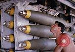 Image of airman near bomb bay of B-52 D bomber Thailand, 1969, second 11 stock footage video 65675039076