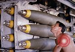 Image of airman near bomb bay of B-52 D bomber Thailand, 1969, second 12 stock footage video 65675039076