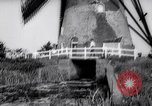 Image of windmills Kinderdijk Holland, 1963, second 9 stock footage video 65675039179