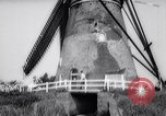 Image of windmills Kinderdijk Holland, 1963, second 10 stock footage video 65675039179