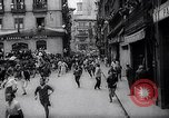 Image of Running of bulls Pamplona Spain, 1963, second 6 stock footage video 65675039203