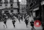 Image of Running of bulls Pamplona Spain, 1963, second 7 stock footage video 65675039203