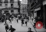 Image of Running of bulls Pamplona Spain, 1963, second 8 stock footage video 65675039203