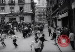 Image of Running of bulls Pamplona Spain, 1963, second 9 stock footage video 65675039203