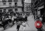 Image of Running of bulls Pamplona Spain, 1963, second 10 stock footage video 65675039203