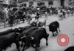 Image of Running of bulls Pamplona Spain, 1963, second 12 stock footage video 65675039203