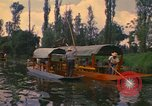 Image of Trajinera boats Mexico City Mexico, 1975, second 12 stock footage video 65675039469