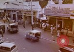 Image of traffic in Jakarta shopping area Jakarta Indonesia, 1964, second 1 stock footage video 65675039494