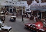 Image of traffic in Jakarta shopping area Jakarta Indonesia, 1964, second 3 stock footage video 65675039494