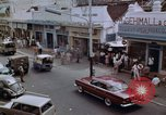 Image of traffic in Jakarta shopping area Jakarta Indonesia, 1964, second 4 stock footage video 65675039494