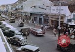 Image of traffic in Jakarta shopping area Jakarta Indonesia, 1964, second 7 stock footage video 65675039494