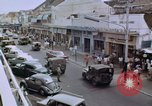 Image of traffic in Jakarta shopping area Jakarta Indonesia, 1964, second 9 stock footage video 65675039494