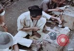 Image of ring maker in Jakarta market Jakarta Indonesia, 1964, second 7 stock footage video 65675039495