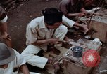 Image of ring maker in Jakarta market Jakarta Indonesia, 1964, second 8 stock footage video 65675039495