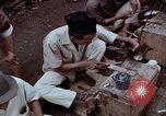 Image of ring maker in Jakarta market Jakarta Indonesia, 1964, second 9 stock footage video 65675039495