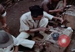 Image of ring maker in Jakarta market Jakarta Indonesia, 1964, second 10 stock footage video 65675039495