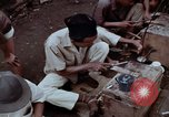 Image of ring maker in Jakarta market Jakarta Indonesia, 1964, second 11 stock footage video 65675039495