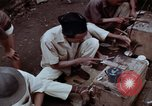 Image of ring maker in Jakarta market Jakarta Indonesia, 1964, second 12 stock footage video 65675039495