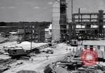 Image of Constructing a petroleum processing facility United States USA, 1943, second 2 stock footage video 65675039521