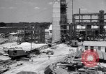 Image of Constructing a petroleum processing facility United States USA, 1943, second 3 stock footage video 65675039521