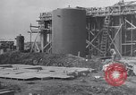 Image of Constructing a petroleum processing facility United States USA, 1943, second 4 stock footage video 65675039521