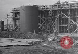 Image of Constructing a petroleum processing facility United States USA, 1943, second 5 stock footage video 65675039521
