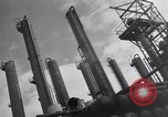 Image of Constructing a petroleum processing facility United States USA, 1943, second 10 stock footage video 65675039521