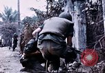 Image of American soldier Saigon Vietnam, 1968, second 3 stock footage video 65675039544