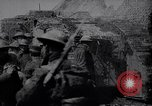 Image of British Mark IV tank with infantry in World War I Western Front, 1917, second 4 stock footage video 65675039556