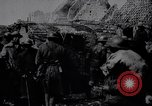 Image of British Mark IV tank with infantry in World War I Western Front, 1917, second 8 stock footage video 65675039556