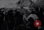 Image of British Mark IV tank with infantry in World War I Western Front, 1917, second 11 stock footage video 65675039556