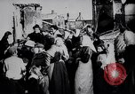 Image of British soldier reads news to civilians Europe, 1918, second 7 stock footage video 65675039557