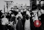 Image of British soldier reads news to civilians Europe, 1918, second 8 stock footage video 65675039557