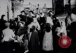 Image of British soldier reads news to civilians Europe, 1918, second 11 stock footage video 65675039557