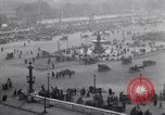 Image of French crowd inspects captured German equipment Paris France, 1918, second 2 stock footage video 65675039627