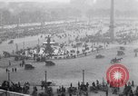 Image of French crowd inspects captured German equipment Paris France, 1918, second 7 stock footage video 65675039627