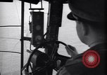 Image of pilot in cockpit of blimp New York United States USA, 1945, second 7 stock footage video 65675039817